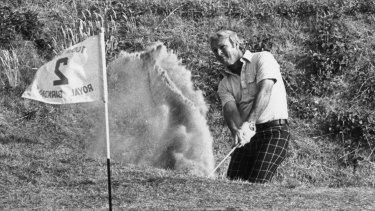 July 1976: Arnold Palmer hits a shot from the bunker onto the green during a match at the Royal Birkdale, Lancashire.