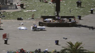 The day after the shooting, bodies remained on the ground, covered by sheets.