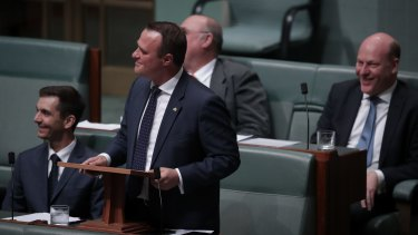 Liberal MP Tim Wilson proposes to his partner Ryan Bolger during debate on the marriage bill on Monday.