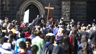 Crowds gather for the Way of the Cross procession in Melbourne.