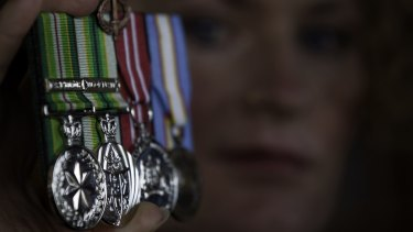 Bridget Clinch pictured in 2010 with the medals she was awarded for two tours of duty in East Timor.