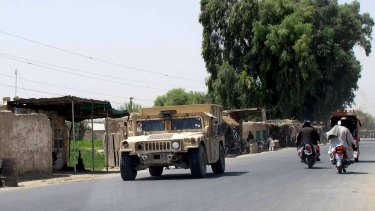 An Afghan armoured police vehicle patrolling in Lashkar Gah capital of Helmand province on Wednesday.