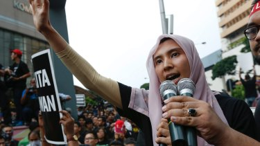 Lawmaker and a vice-president of the People's Justice Party Nurul Izzah Anwar, daughter of oppression leader Anwar Ibrahim, speaks to protesters in 2015.