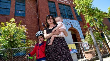 Sara Mckenzie with son Wesley, who has chickenpox despite being vaccinated, and daughter June.