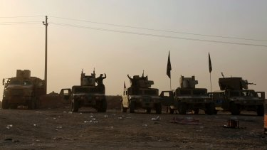 Iraqi soldiers outside Mosul on Wednesday. A senior Iraqi general called on Iraqis fighting for the Islamic State group in Mosul to surrender.