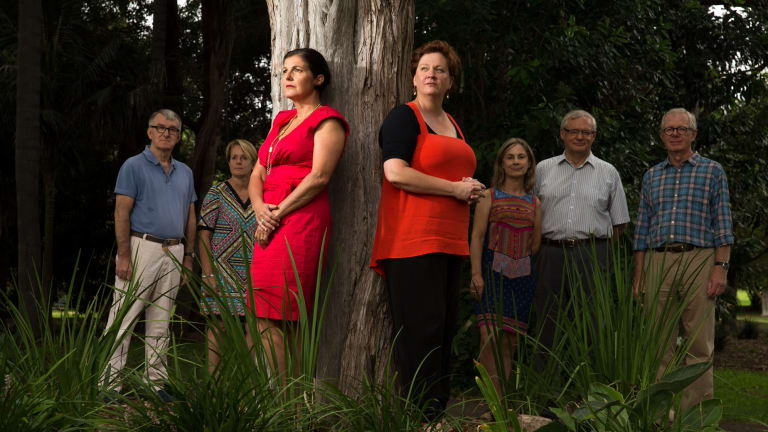 Foreground, Emma Rossi, left, and Liz Mackinlay, with Michael Gill, Fiona Pollack, Janice Gibson, Roger Williams and Richard Harpman, are organising the establishment of a women's shelter in North Sydney.
