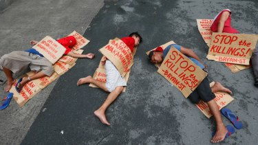 "People stage a ""die-in"" to protest the rising number of extra judicial killings related to Philippine President Rodrigo Duterte's ""War on Drugs""."