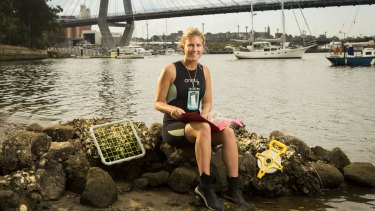 """Gardening: Marine Ecology student Rebecca Morris with marine """"flowerpots"""" used for increasing biodiversity for the harbour's sea walls."""