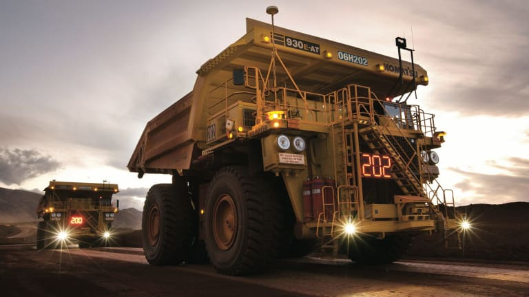Rio Tinto, which operates the world's biggest fleet of autonomous trucks, has used technology to cut haul and load costs in its iron ore division.