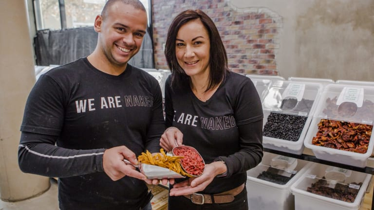 Naked Foods CEO and director Caique Ponzoni, left, with Canberra store owner Vashti Biffanti.