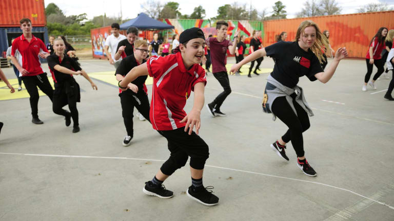 From left, Calwell High school year 10 students, Jacob Brown, 15, of Gilmore and Grace Forbes, 15, of Jerrabomberra take part in the outdoor dance jam held at the Westside Acton Park for the launch of Ausdance ACT Australian dance week in Canberra.