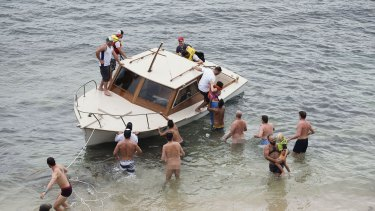 It quickly became apparent that those on board needed help - and luckily, some keen swimmers leapt into action.