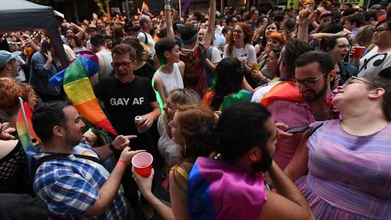 Melburnians partied into the night outside Trades Hall after the ''yes'' vote prevailed.