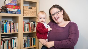 Erin Riley and her 9-month old daughter Abby at their rented home in Panania.