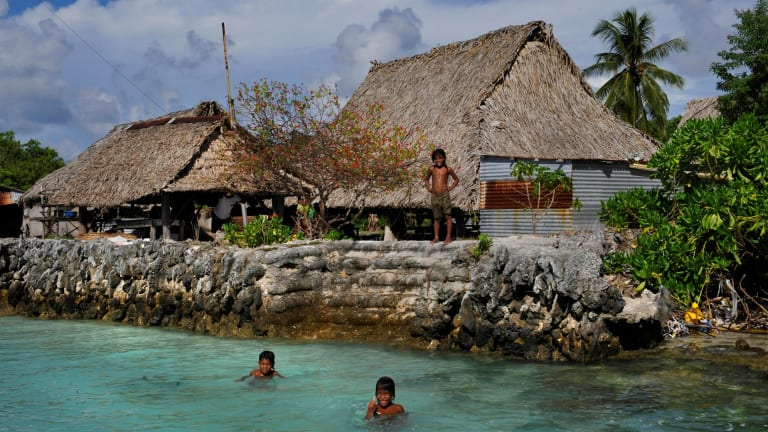 The village of Tebunginako in the Kiribati islands had to move because of rising seas and erosion. The new village (pictured) is now under threat of inundation and sea walls have to be constantly maintained.