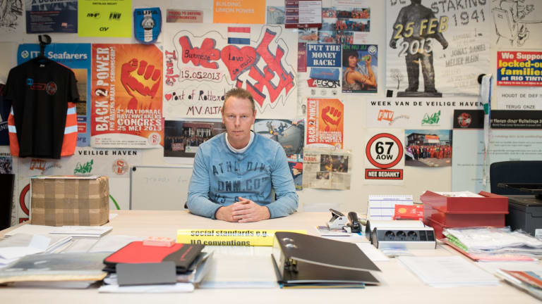 Niek Stam in his office in Rotterdam, Netherlands. In the 1970s, Rotterdam was the world's largest port and 25,000 stevedores worked there.