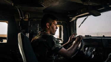 An Iraqi army soldier drives a Humvee in the outskirts of Kabrouk in May.