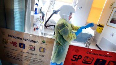 Royal Melbourne Hospital staff demonstrate personal protective equipment used if someone presents with Ebola Virus.
