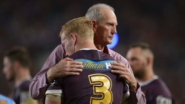 Gut wrenching: Wayne Bennett consoles Jack Reed after the grand final loss to the Cowboys.