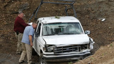 Investigators view a pickup truck involved in a deadly shooting at the Rancho Tehama Reserve.