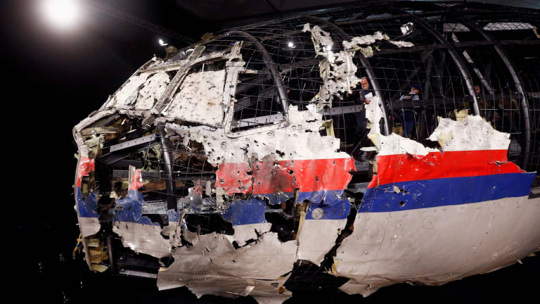 Cockpit wreckage reconstruction of MH17 at the Gilze-Rijen Military Base in the Netherlands.
