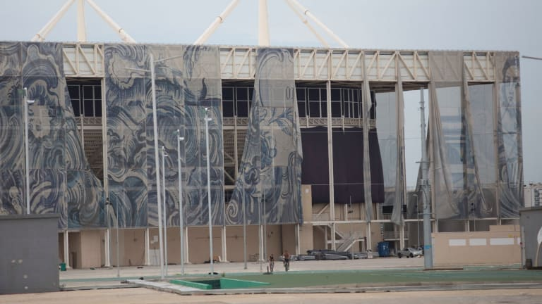 The translucent tapestries created by Brazilian artist Adriana Varejao fall from the exterior of the aquatic stadium in February.