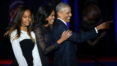 President Obama is joined by first lady Michelle Obama and daughter Malia after his farewell speech in Chicago on January 10, 2017.
