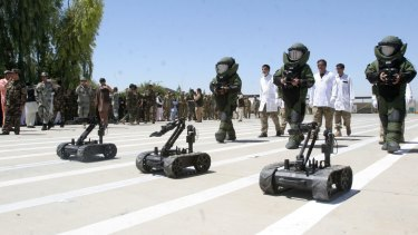 Afghanistan's National Army explosive disposal personnel in a parade in Lashkar Gah, Helmand, earlier this month.
