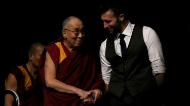 Former Olympic swimmer Ian Thrope introduces His Holiness the 14th Dalai Lama during a teaching visit at the Brisbane Convention and Exhibition Centre.