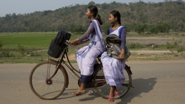 Girls go to school at Roja Mayong village about 40 kilometres east of Gauhati, India.