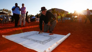 The Uluru Statement - the signing of which by Noel Pearson is shown here - called for a move to a national treaty.
