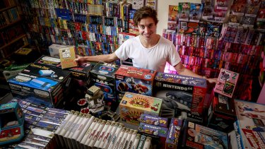 Sam Crowther and his Nintendo video games collection.