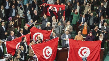 January 2014: Members of the Tunisian National Constituent Assembly celebrate the adoption of a new constitution in Tunis.