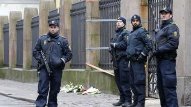 Danish police officers secure the area outside of a synagogue on Sunday.
