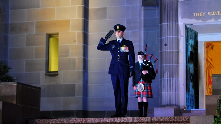 Squadron Leader Marcus Watson during the Last Post ceremony at the Australian War Memorial in Canberra for Flight Lieutenant John Napier Bell.