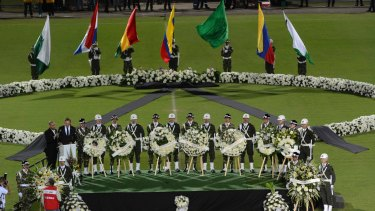 Soldiers and police attend a tribute to members of Brazil's Chapecoense soccer team who died in a plane crash, at the stadium where they were to play a game in Medellin, Colombia.