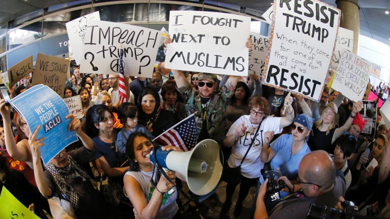 Demonstrators gather outside Los Angeles International Airport.