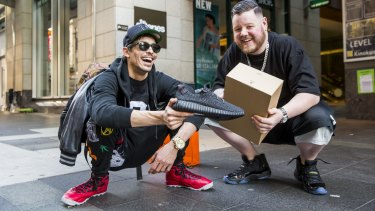 Jordan David and Dustin Crawley with their new sneakers and prized sneaker box.