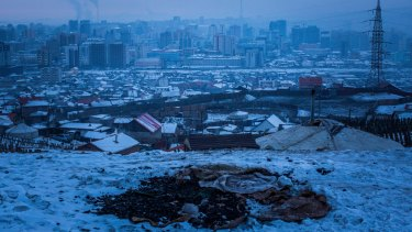A pile of coal exposed in the snow on an abandoned lot in Ulaanbaatar, Mongolia. The burning of raw coal in the city will be banned from April 2019.