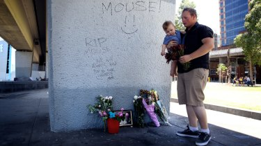 Senseless killing: Wayne Perry's son Brad Anderson visits the place where his father was fatally stabbed.