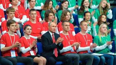 Russian President Vladimir Putin, centre, applauds during a meeting with students in Yaroslavl, Russia, on Friday where he discussed artificial intelligence.