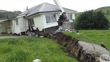 The New Zealand earthquake moved parts of the country several metres, such as this house on the Kaikoura Coast.
