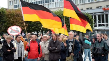 People take part in a demonstration in the east German city of Bautzen on Sunday.