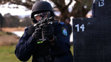 A member of the NSW Public Order and Riot Squad with a newly-issued Colt M4 assault rifle.
