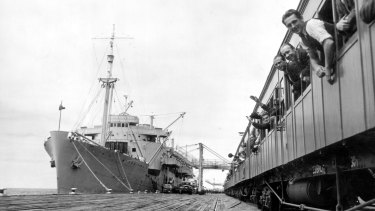 A train takes new arrivals from the Baltic countries from HMAS Kanimbla, docked in Melbourne, to Bonegilla reception centre.