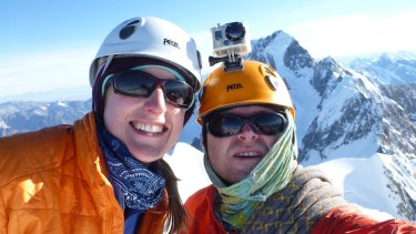 Dale Thistlethwaite and Stuart Hollaway on the summit of Rarakiroa/Mt Tasman, with Mount Cook in the background.