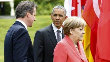 German Chancellor Angela Merkel walks with US President Barack Obama and British Prime Minister David Cameron at the G7 summit.
