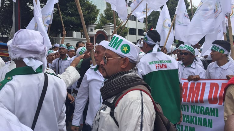 Demonstrators rally in Jakarta on Friday to demand the arrest of the city's governor.