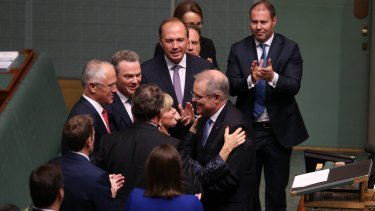 Treasurer Scott Morrison is congratulated by Minister Julie Bishop after he gave the Budget address at Parliament House in Canberra.