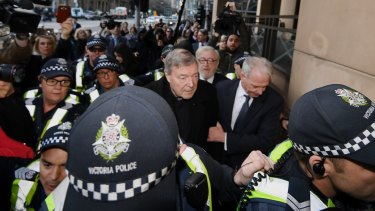 Cardinal George Pell arrives at Melbourne Magistrates Court surrounded by police, and his lawyers.